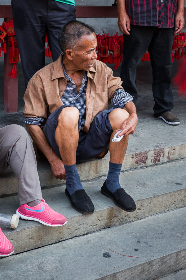 Chinese man sitting in in Prince Gong's mansion, Beijing, China
