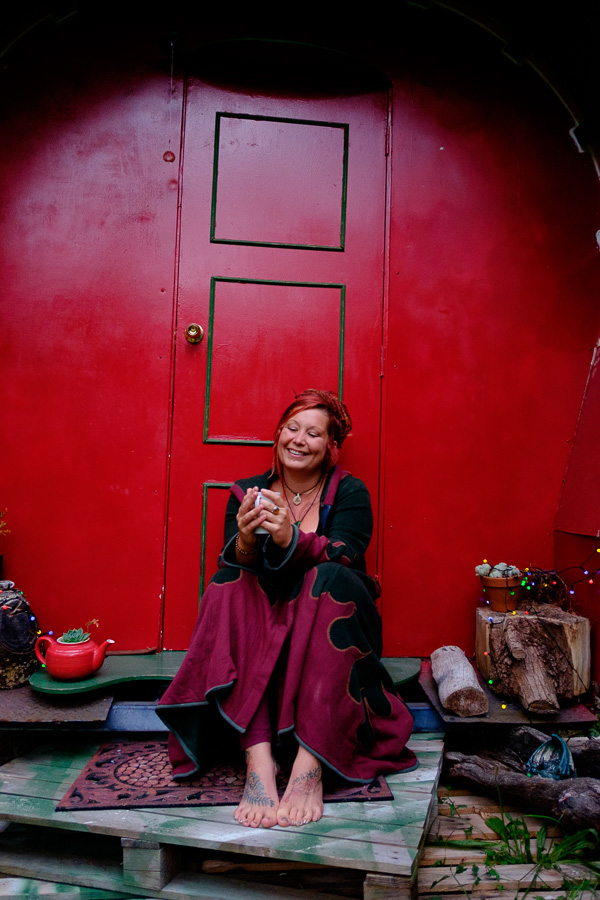 Portrait of a woman sitting in front of a gypsy caravan, , illustrating an article about framing, placement and compostion.