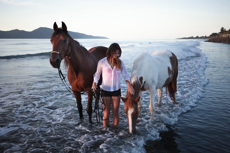 Photo of a woman with two horses on the Kapiti Coast, New Zealand, taken with 40mm prime lens