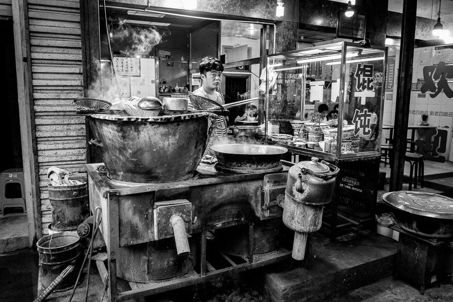 Street photo of food vendor taken in Xi'an, China with Fujifilm camera