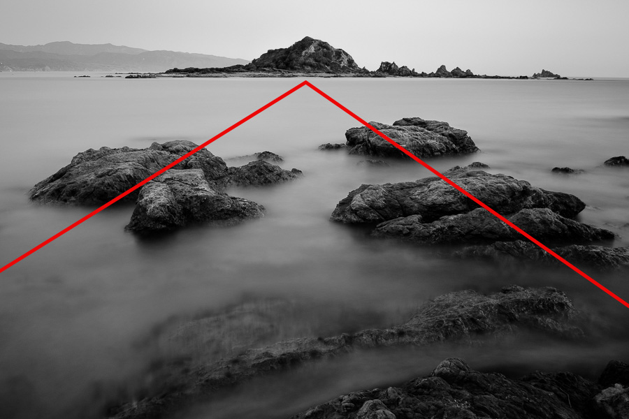Black and white landscape photo taken in Island Bay, New Zealand with red lines to mark lines formed by rocks