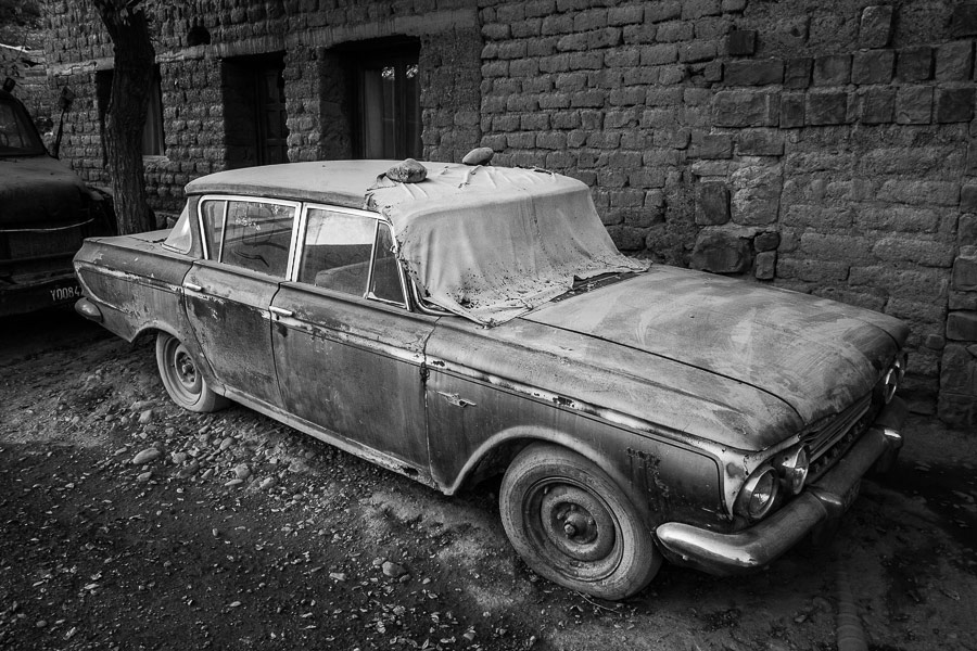 Black and white photo of old car