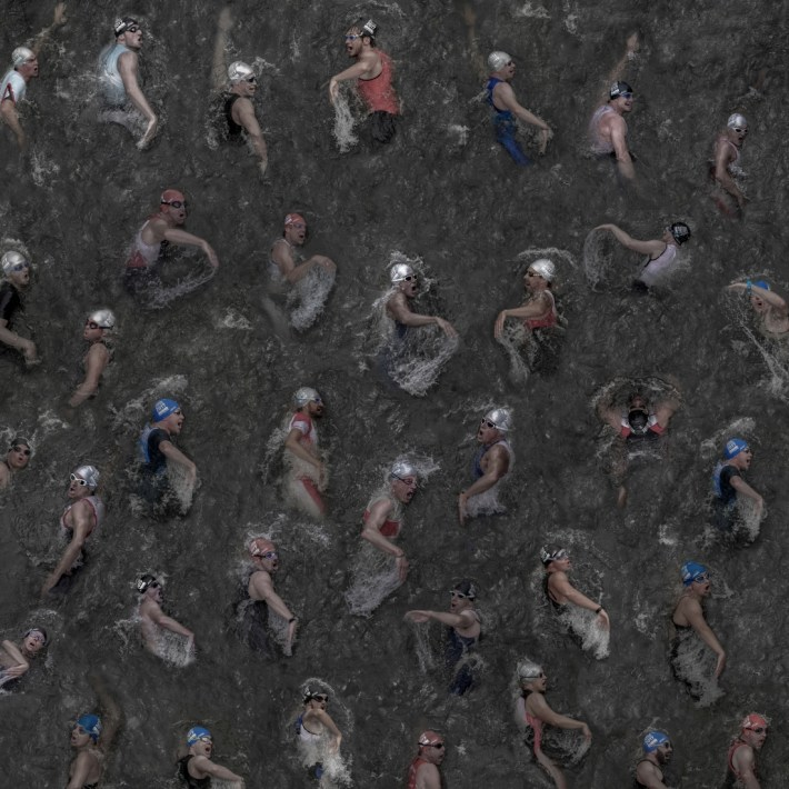 """The picture was taken in summer 2017 from 35 individual images of swimmers at the triathlon in the Duesseldorf Media Harbor. I was able to take a picture of them from above, while the athletes crossed a pedestrian bridge capturing their very individual """"breathing techniques"""". I was inspired by the work of Andreas Gursky, therefore I took the individual images with the highest possible sharpness. That enables me to display or print the overall picture in large format. Copyright: © Klaus Lenzen, Germany, Shortlist, Open, Enhanced (Open competition), 2018 Sony World Photography Awards"""