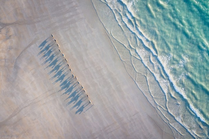 Enjoying the sunset from the famous Cable Beach and watching the camels walking by. Shot taken with DJI Mavic Pro. Copyright: © Jonas Börnicke, Germany, Shortlist, Open, Travel (Open competition), 2018 Sony World Photography Awards