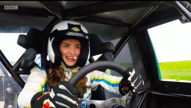 Racing car driver behind the wheel
