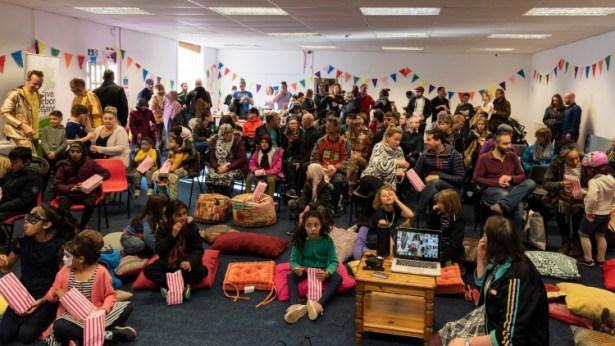 Festive audience sitting inside