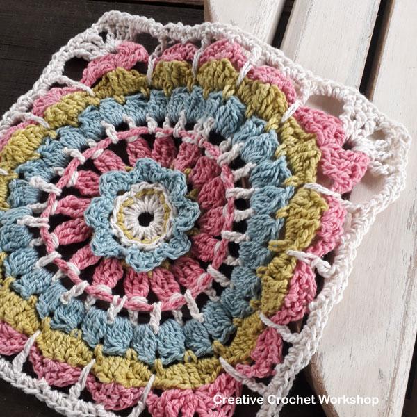 Flower Wheel Window Square - Free Crochet Pattern | Creative Crochet Workshop @creativecrochetworkshop #afghansquare #freecrochetpattern #flowerwheelwindowsquare