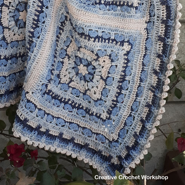 Snuggled Hearts Baby Blanket | Creative Crochet Workshop @creativecrochetworkshop #crochetalong #grannysquare #afghansquare #crochetbabyblanket #ccwsnuggledheartsblanket #madewithheart