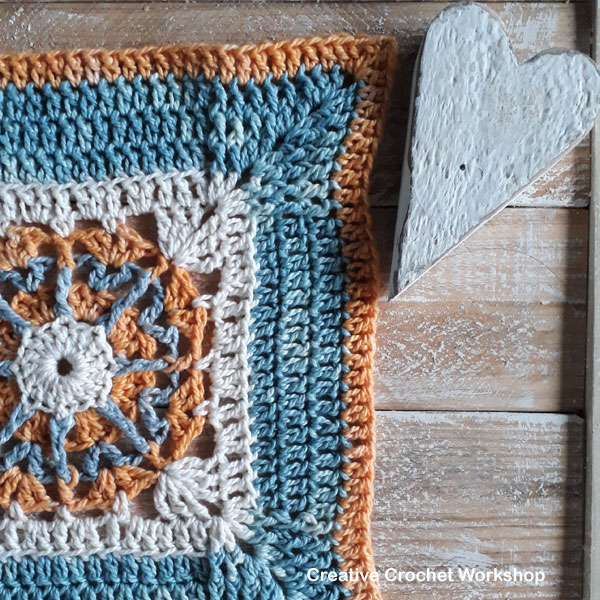 Framed Spiked Wheel Square - Free Crochet Pattern | Creative Crochet Workshop @creativecrochetworkshop #freecrochetpattern #grannysquare #afghansquare #crochetalong #ccwcrochetablock2019