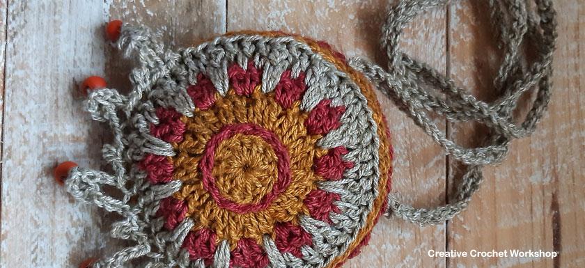 Rustic Boho Neck Purse - Free Crochet Pattern | Creative Crochet Workshop @creativecrochetworkshop #freecrochetpattern #crochetaccessory #bohocrochet #bohemian #crochet