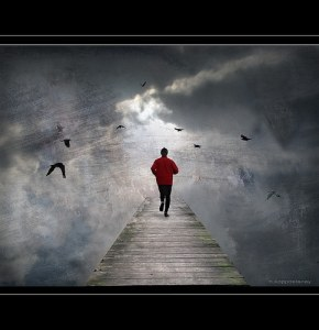 creative writing confidence | image of a man in a red jacket running into the distance on a jetty. It is foggy and he can't see infornt of him but he runs with confidence