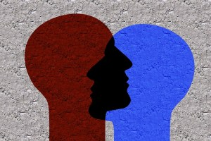 dialogue - An image of two heads in conversation