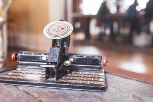 self-publishing a book | an image of an old fashioned type writer