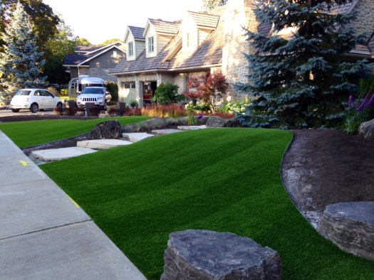 Cross stitched Ez Grass artificial synthetic front yard turf installation.