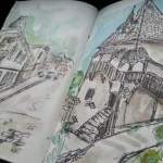 Sketching buildings in watercolor