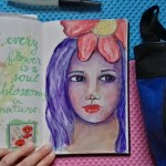 Art in my journal: Whimsical Face with purple hair and the Quoted Pages