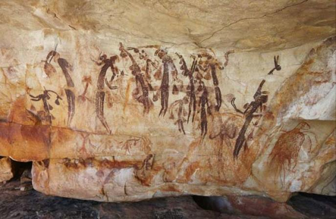 Photo of Gwion Gwion (Bradshaw) paintings on a rock wall.