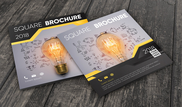Brochure Mockup on Wooden Surface Free PSD