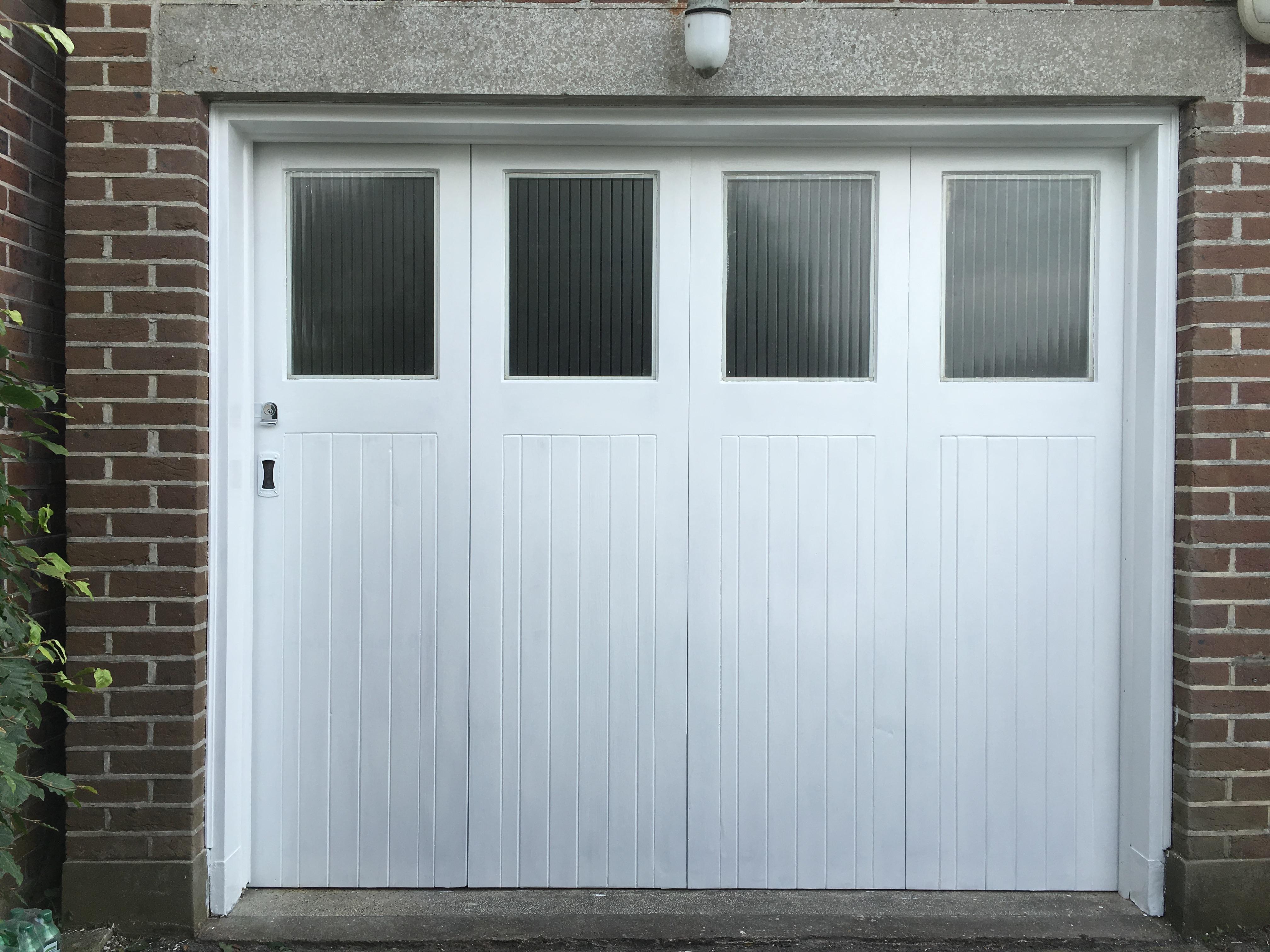 Restored bi-fold garage doors