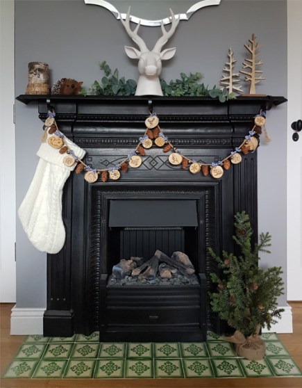 a photo of a garland fireplace