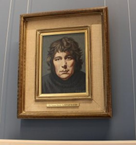 a picture of Seamus Heaney painting at the national gallery of ireland