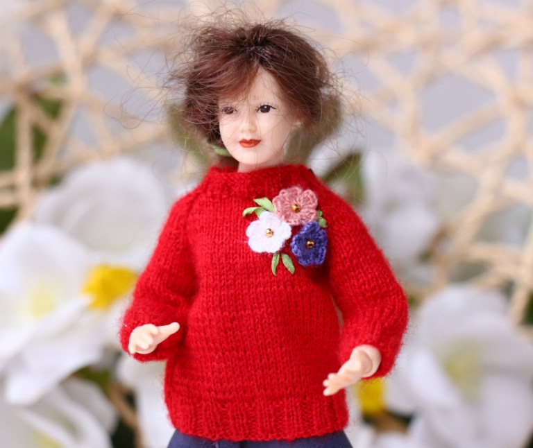 Heidi Ott lady doll red sweater.