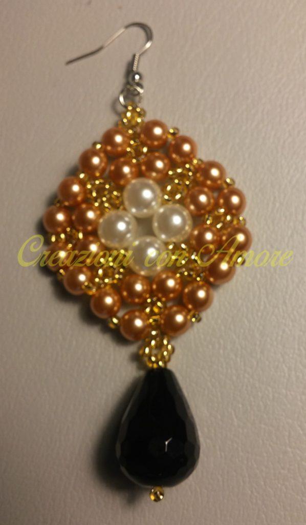 Orecchini a rombo in perle rame