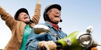 Happy Retired Couple on Motorcycle