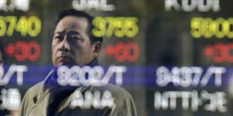 Man looking at stock index