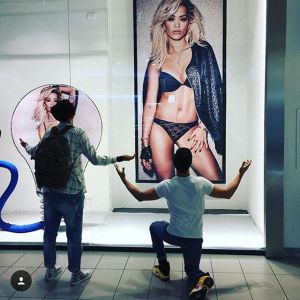 Fans proposes to a poster showing Rita Ora in Blue pant and Bra