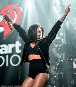 Demi Lovato sizzles in skimpy outfit as she flashes her abs on Stage at Jingle Ball in Boston