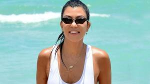 Kourtney Kardashian puts on display her Toned Body at Miami Beach In High-Waisted White Swimsuit