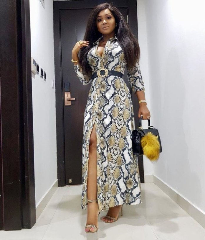 Mercy Aigbe Bares Cleavage As She Steps Out In Snake Print Outfit