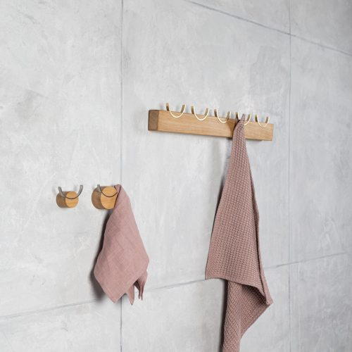 Wooden coat rack, brass hooks