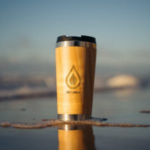 Bamboo 420ml eco travel coffee cup - coffee cup in water 500x500