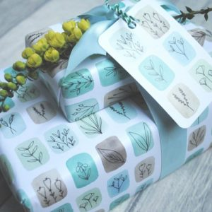 Floral stamp gift wrap. 100% recyclable. Pack of 25 sheets with matching tags