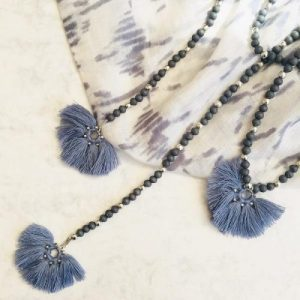 Long blue bead and tassel necklace