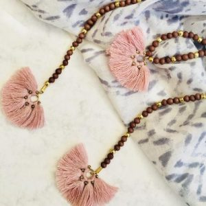 Long pink bead and tassel necklace