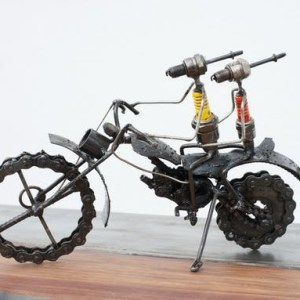 Motorcyclists made from recycled spark plugs and motorcycle parts