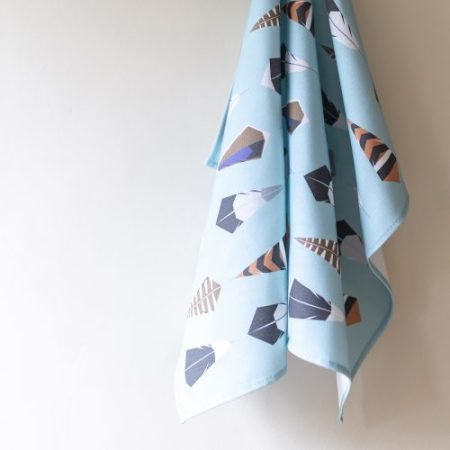 100% cotton Tea Towel with geometric feathers printed on