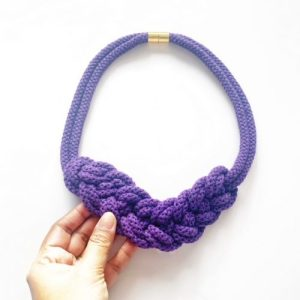 A purple cotton necklace with magnetic closure against white background