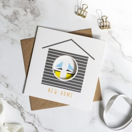New Home card with circle cut out to reveal the printed design inside.
