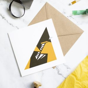 Oriole card. Geometric design with kraft envelope