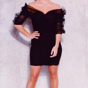 Couture Dress. Black V-Neck dress with midi sleeves.