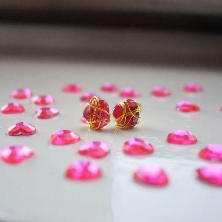 Pink Bunmi wraps golden stud earrings