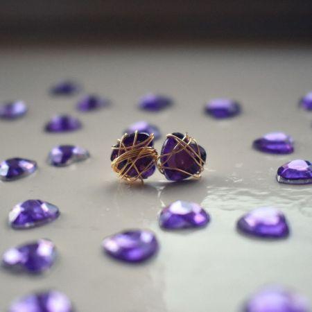 Purple Bunmi wraps golden stud earrings