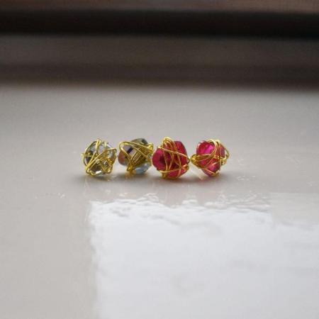 Clear Bunmi wraps golden stud earrings
