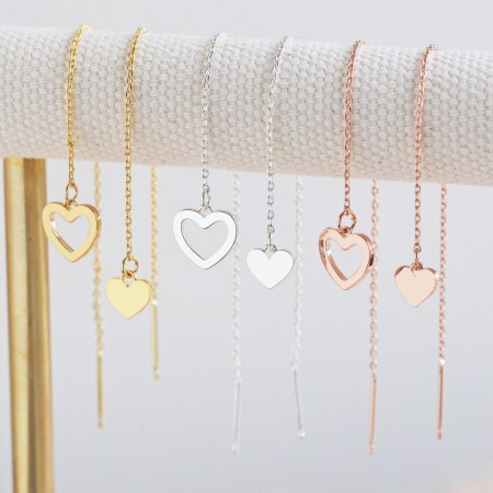 Thred throw Mismatched Heart Earrings in Gold