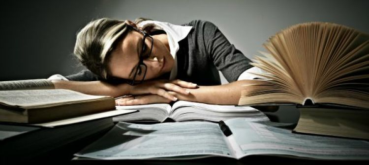 Tired woman student sleeping in the office.