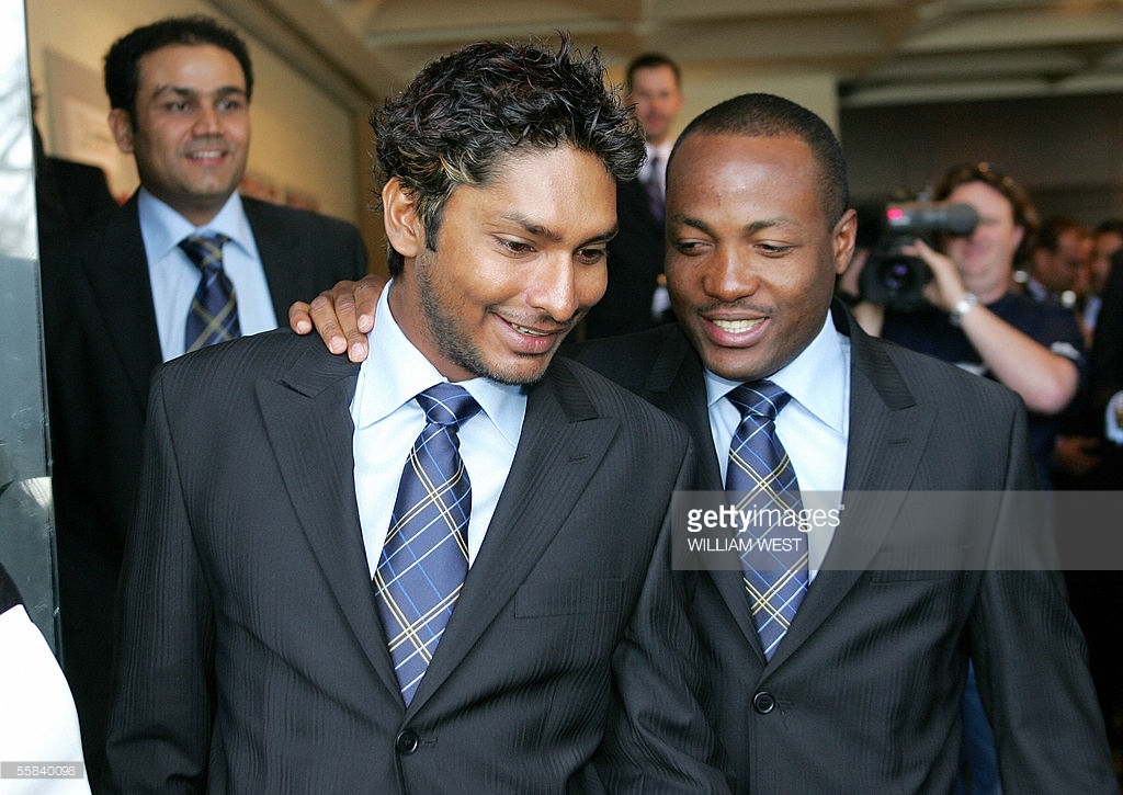 Members of the International Cricket Council (ICC) World XI cricket team, Kumar Sangakkara (L) and West Indies Brian Lara (R) chat after a press conference, in Melbourne 03 October 2005. The ICC World XI will play three one-day matches against Australia under a closed roof in the 50,000 seater Docklands Stadium before moving to Sydney where they will play a six-day Test Match. AFP PHOTO/William WEST